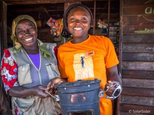 Nanbet Magdalene with a clean cook stove customer, Nigeria