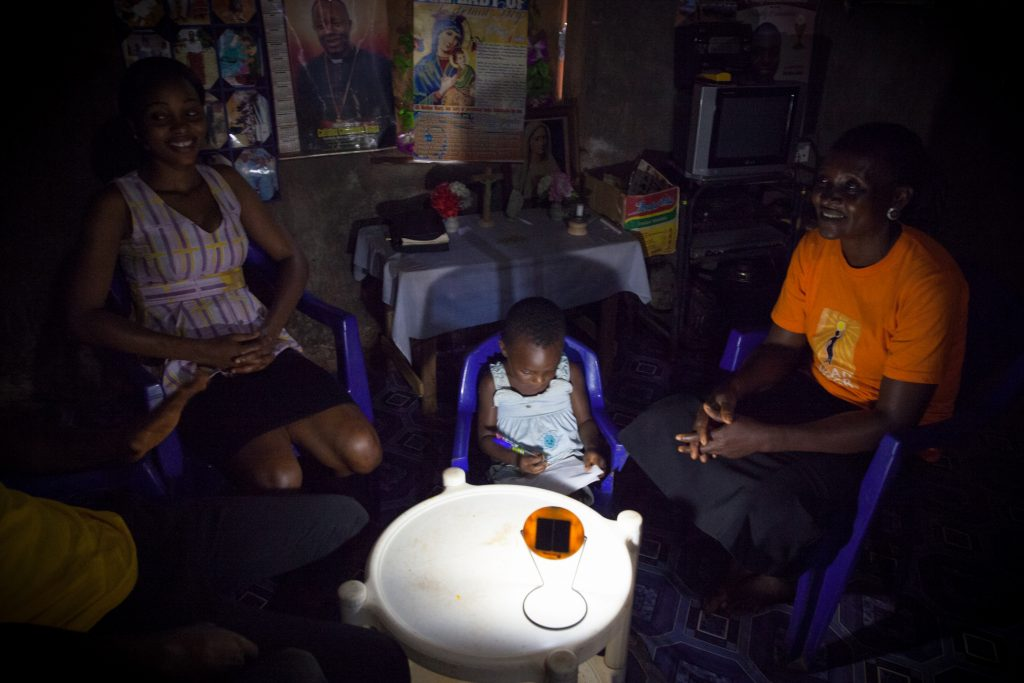 family members talk by solar light