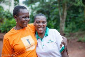 Women smiling hug in Nigeria