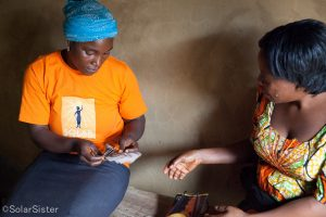 Woman entrepreneur pays for solar products