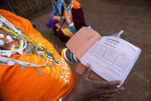 woman holds receipt book for solar business